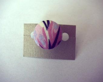 Handmade pink purple and white petal floral print fabric button ring. Silver plated adjustable band
