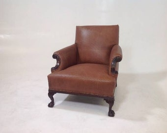 Antique ball and claw leather club chair