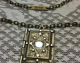 Multi strand locket necklace