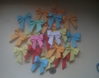 folded paper bows x4