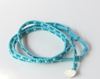 multi wrap bracelet in turquoise waxed cotton with silver button and toning seed beads - KNO-56
