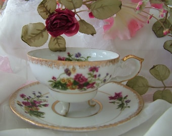 Ucagco Japan china tea cup on legs saucer red carnations