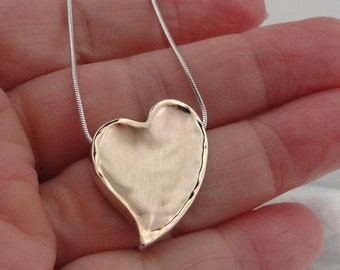 DUERRY's UNEQUAL HEART Silver & Gold pendant
