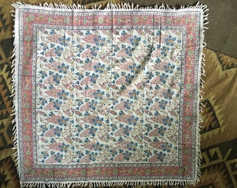 A colorful vintage table cover textile