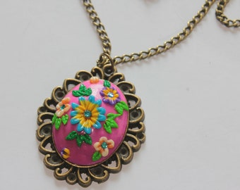 Polymer clay floral pendant