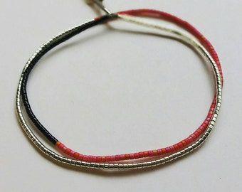 Colorblock wrap bracelet in silver, raspberry, and black.