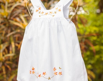 Cotton girl dress embroidered with orange flowers