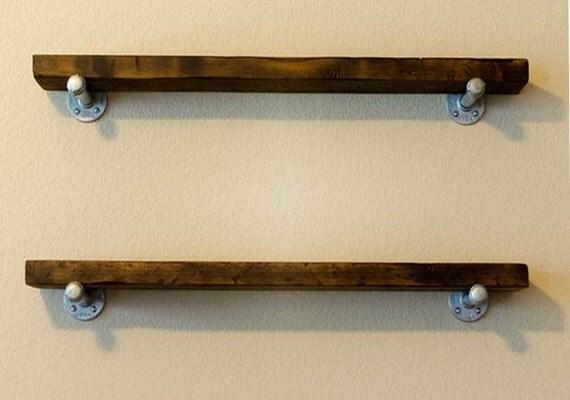 industrial floating shelf with galvanized pipe brackets. Black Bedroom Furniture Sets. Home Design Ideas