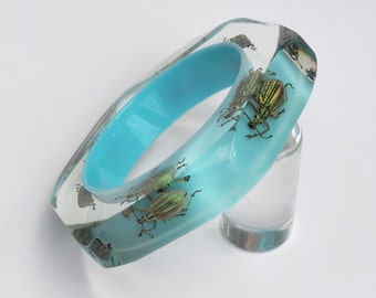 Faceted blue lucite bracelet with real beetles