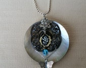 Layered Round Shell Pendant with Rhinestones and Butterfly