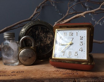 VINTAGE CLOCK...travel clock ~ Germany ~ folding watch alarm ~ covered case ~ Europa 2 jewels ~ needs screws