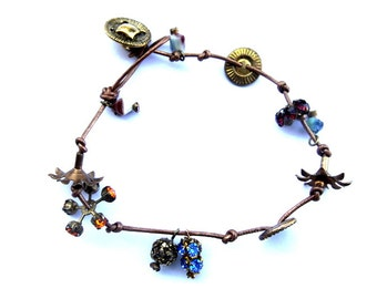 Bracelet button jewelry made of vintage buttons, vintage Swarovski beads and flowers beaded on a leather cord  12.5inch