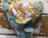 Heart in handmade fabric yarn with flower brooch