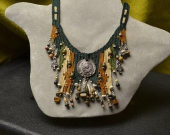 Metallic, beaded and fiber necklace 765