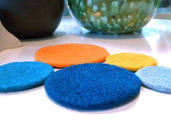 felted wool trivet, small, teals, seafoam, bright orange, and yellow (1973)