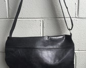 Simple black leather cross-body bag, suitable for a 10 inch tablet made in Canada