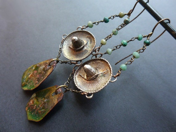 Anemia. Green assemblage earrings with sterling silver sombrero charms.