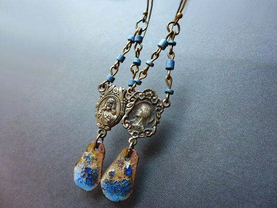 The Devil Will Come. Rustic assemblage earrings with rosary centers in blue.