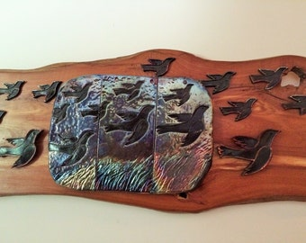 Birds in Flight  Raku assembledge on cedar board