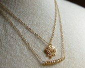 Layered Gold Chain Necklace with Gold Lotus Charm and Gold Glass Beaded Bar Pendant