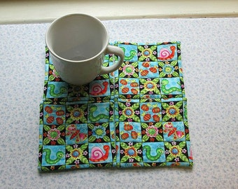 snails caterpillars and butterflies set of mug rugs