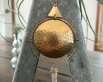 Hammered brass dome with quartz