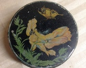 Antique Victorian black metal tin can canister with flower and butterfly