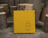 hand-bound and embroidered little wool felt journal: cat in ochre by kata golda