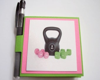 Exercise kettlebells and weights Post it note holders with gel pen