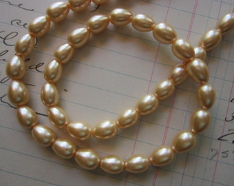 40 glass pearls - 7mm x 10mm oblong - CREAM/HONEY color - coated glass beads - 14 inch strand