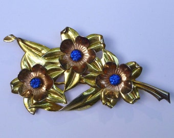 Large Gold Tone Sterling Silver Flower Brooch With Sapphire Blue Crystals