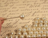 65 faux pearl beads