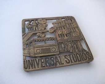 RETRO Hot Plate, vintage 1960s UNIVERSAL STUDIOS brass trivet - Hollywood souvenir with film crew, movie sets, & movie stars