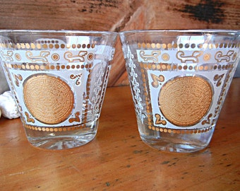 Bar Glasses with Aztec Sun Calendar Design Vintage Mod MCM gold and frosted white set of two Tumblers Rocks Barware Drinking glasses