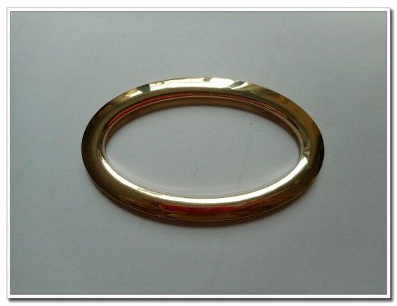 A pair 3 1 2 inch inner diameter gold oval metal purse for Liner diametre 4 50