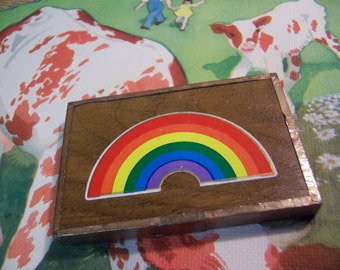 copper and wood rainbow mirror