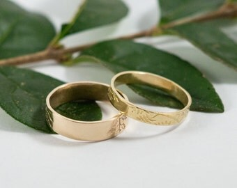 Gold Botanical Wedding Bands: A Set of his and hers textured 14k gold wedding rings