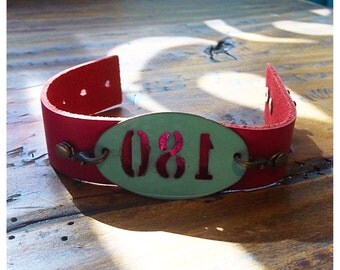 "Pink leather bracelet with reverse ""180"" painted teal tag"