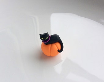 Dollhouse black cat on a pumpkin in 1:12 scale handmade from polymer clay