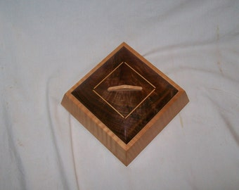 Fiddle Back Maple and Walnut Trapezoid Box Wooden box handcrafted from musical grade fiddle back maple.