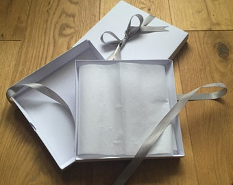 A White Gift Box for purchase with any card, complete with tissue and ribbon