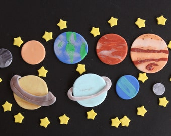 Fondant cupcake toppers--9 planets and 24 small stars