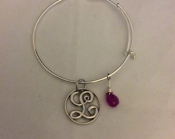 Silver, stainless steel bangle bracelet with initial silver charm and purple jade tear drop stone.