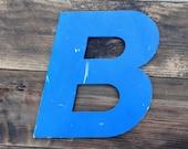 Reclaimed metal letter - e