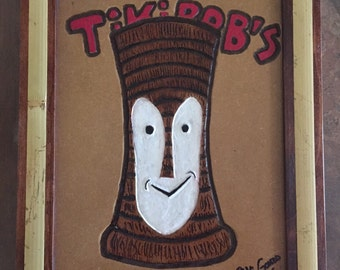 Hand Carved Tiki Bob's on wood with hand made Wooden frame