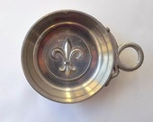 Pewter tastevin, trinket dish, with Fleur de Lys decoration, and serpent handle