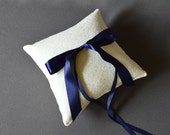 Ivory lace wedding ring pillow with navy blue satin ribbon bow