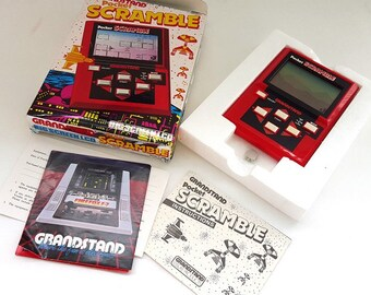 Vintage 1980s Grandstand Pocket Scramble - stand alone hand held video game big screen LCD - MIB mint in box