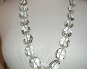 Vintage Long Strand of Clear Cut Crystal Gemstones, Hand Knotted Cord between each crystal with stamped silver clasp in Near Mint Condition