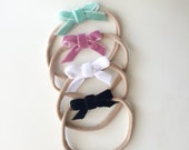 Soft newborn velvet bow headbands, one size fits most, pink, black, white, mint, tiny bows, infant, toddler, stretchy